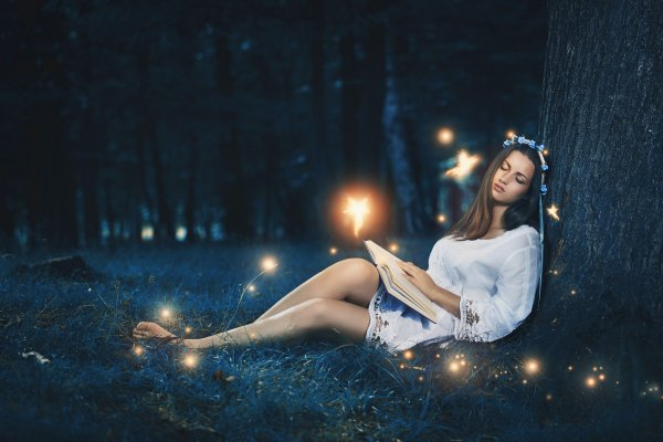 37490693 - beautiful woman sleeping peacefully among the forest fairies . magic and fantasy