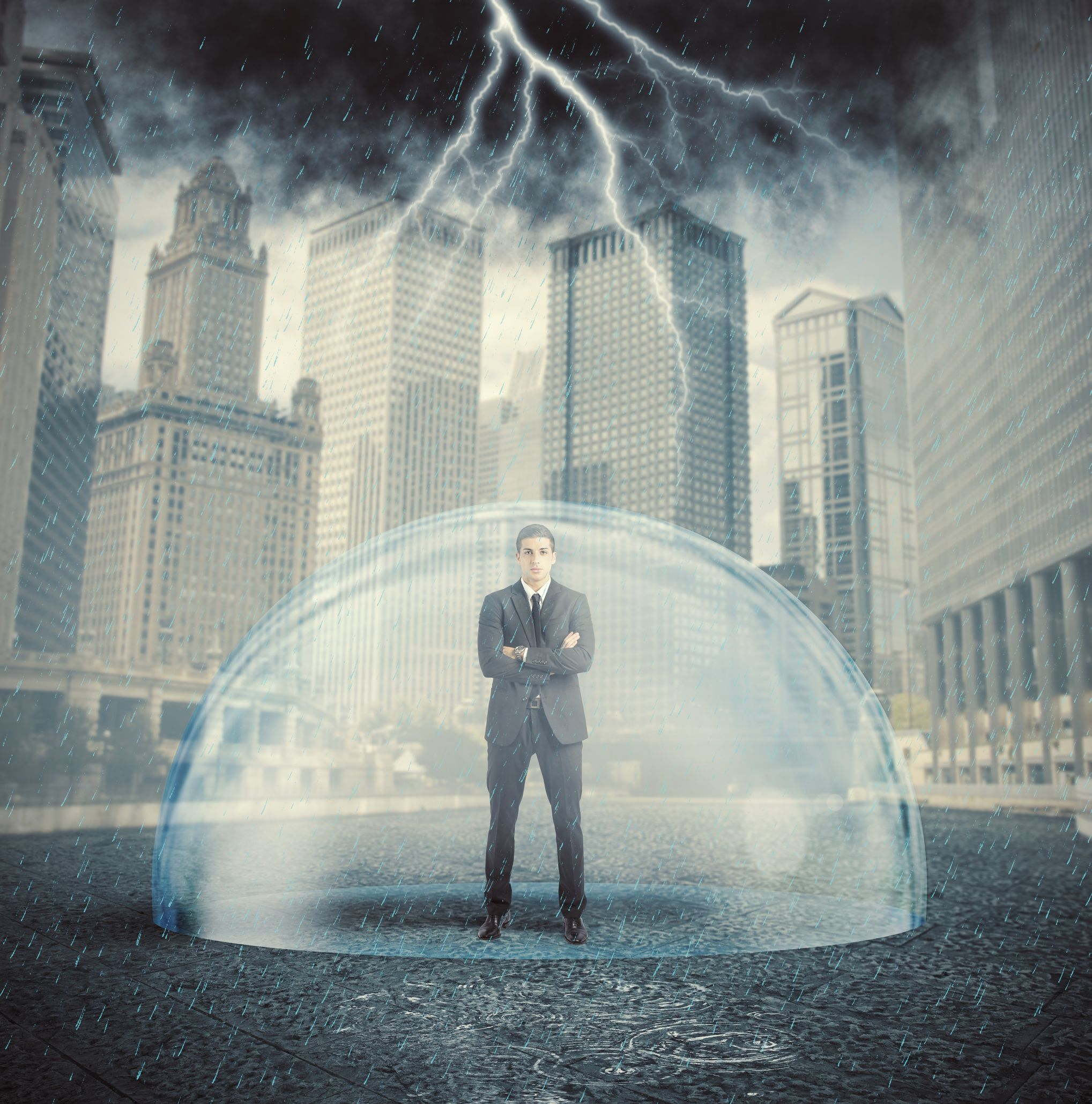 28604797 - businessman protected from the crisis with a crystal ball