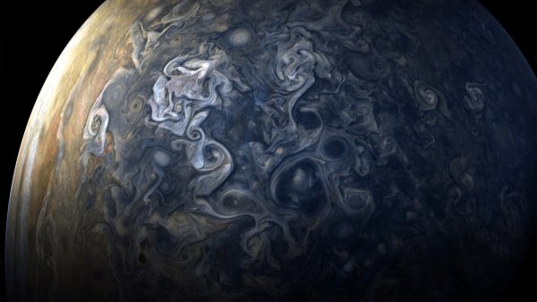 then juno flew back out into deep space passing over jupiters south pole on its exit churning storms at the poles constantly change their appearance