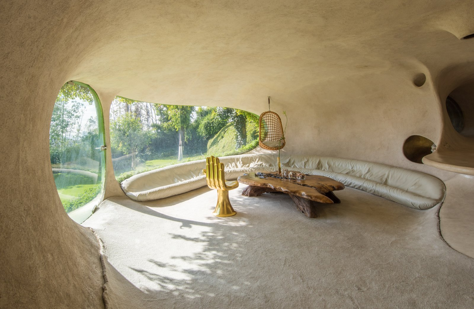 the living room features a bench filled with small polyurethane balls that conform to the shape and weight of the sitter