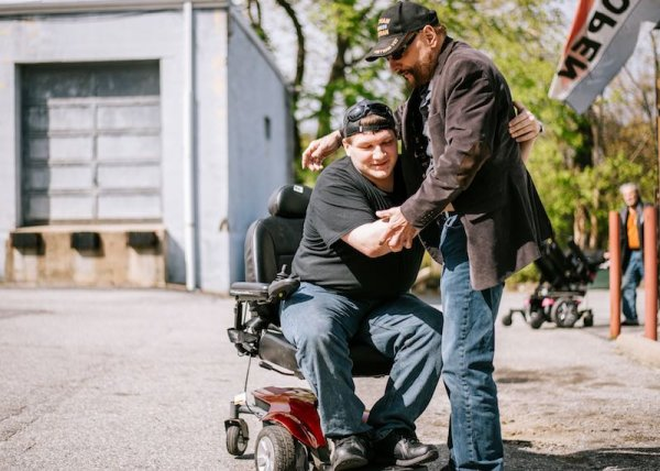 Phillip gives motorized wheelchair Courtesy of GoFundMe Heroes 1