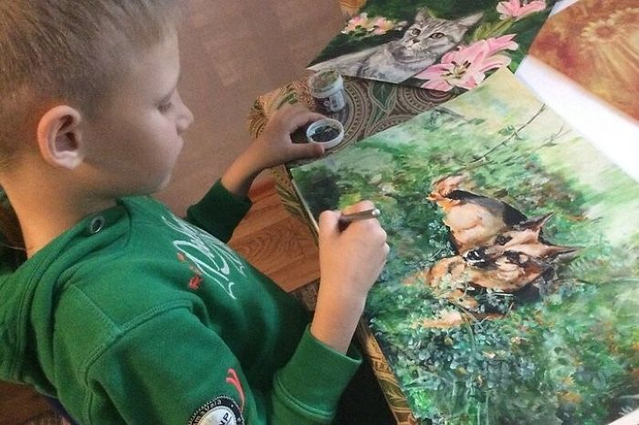 9 year old Russian boy trades his art for abandoned dog food and medicine 5da51714943ec 700