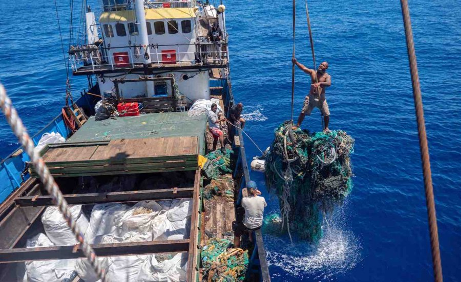 Giant net going into boat hold clean up Ocean Voyages Institute