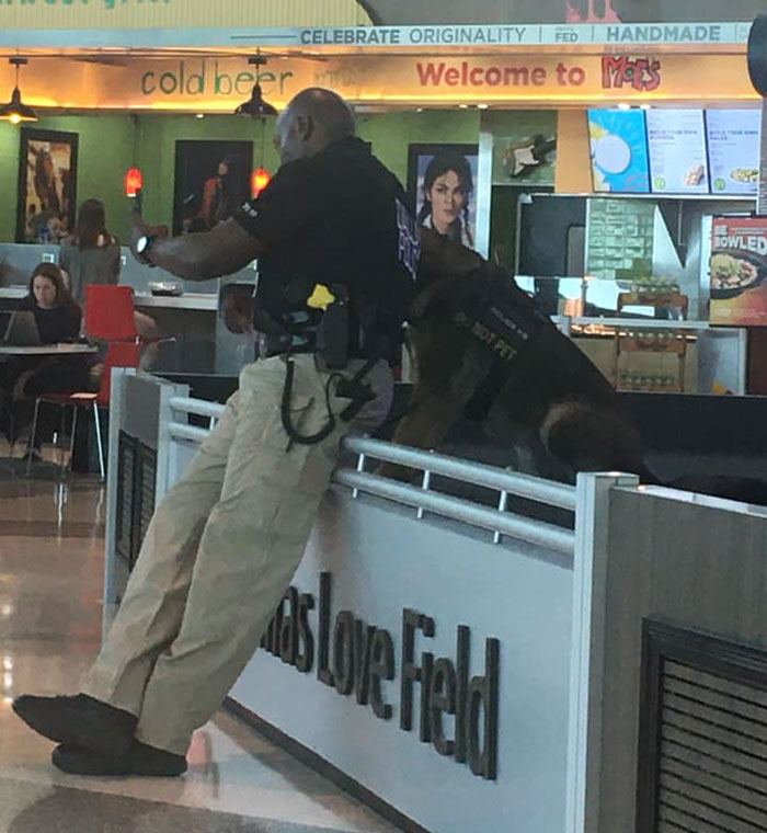 officer taking selfies with his service dog