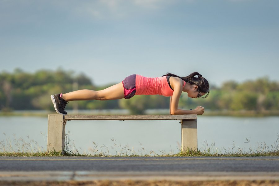 Woman Planking On Bench